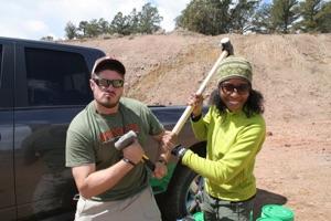 Wes Weisberg and Aisha Morris sledge hammers photo