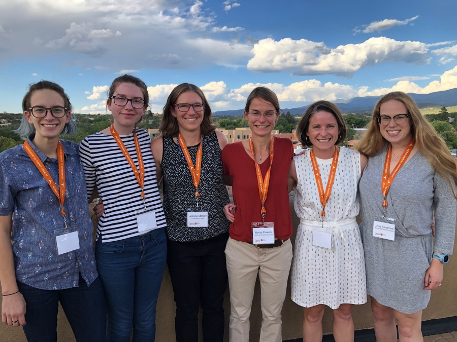 6 superb geologists with Santa Fe at sunset in the background